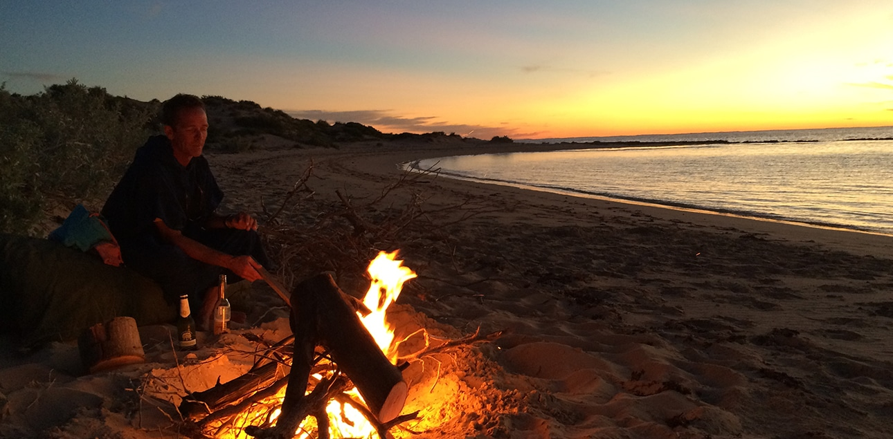 Dive Ningaloo - Dave tending to campfire
